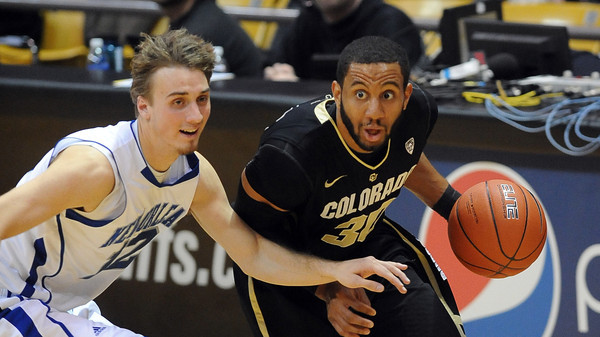 """Carlon Brown of CU drives past Max Banchy of New Orleans in the CU win.<br /> For more photos of the game, go to  <a href=""""http://www.dailycamera.com"""">http://www.dailycamera.com</a>.<br /> December 28, 2011 / Cliff Grassmick"""