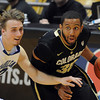 "Carlon Brown of CU drives past Max Banchy of New Orleans in the CU win.<br /> For more photos of the game, go to  <a href=""http://www.dailycamera.com"">http://www.dailycamera.com</a>.<br /> December 28, 2011 / Cliff Grassmick"