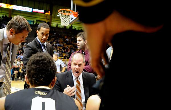 "University of Colorado Head Coach Tad Boyle yells at his team during a timeout while playing against the University of New Orleans on Wednesday, Dec. 28, at the Coors Event Center on the CU campus in Boulder. CU won 92-34. For more photos of the game go to  <a href=""http://www.dailycamera.com"">http://www.dailycamera.com</a><br />  Jeremy Papasso/ Camera"