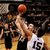 "University of Colorado's Austin Dufault goes for a shot over Lenny Harmon during a game against the University of New Orleans on Wednesday, Dec. 28, at the Coors Event Center on the CU campus in Boulder. CU won 92-34. For more photos of the game go to  <a href=""http://www.dailycamera.com"">http://www.dailycamera.com</a><br />  Jeremy Papasso/ Camera"
