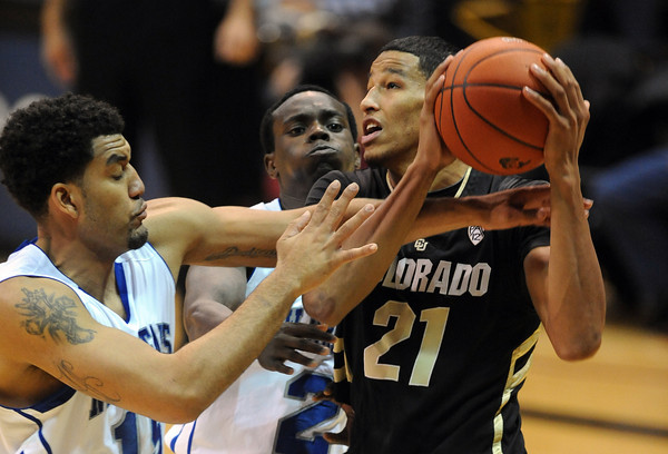 """Andre Roberson (21) of Colorado, gets tied up with Lenny Harmon of New Orleans during the second half of the December 28th, 2011 game in Boulder.<br /> For more photos of the game, go to  <a href=""""http://www.dailycamera.com"""">http://www.dailycamera.com</a>.<br /> December 28, 2011 / Cliff Grassmick"""