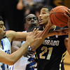 "Andre Roberson (21) of Colorado, gets tied up with Lenny Harmon of New Orleans during the second half of the December 28th, 2011 game in Boulder.<br /> For more photos of the game, go to  <a href=""http://www.dailycamera.com"">http://www.dailycamera.com</a>.<br /> December 28, 2011 / Cliff Grassmick"
