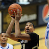 "Andre Roberson of Colorado gets his shot blocked by Antonio Wertz of New Orleans during the first half of the December 28th, 2011 game in Boulder.<br /> For more photos of the game, go to  <a href=""http://www.dailycamera.com"">http://www.dailycamera.com</a>.<br /> December 28, 2011 / Cliff Grassmick"