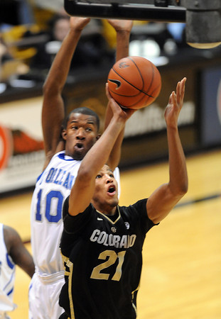 "Andre Roberson of Colorado goes under Antonio Wertz of New Orleans during the first half of the December 28th, 2011 game in Boulder.<br /> For more photos of the game, go to  <a href=""http://www.dailycamera.com"">http://www.dailycamera.com</a>.<br /> December 28, 2011 / Cliff Grassmick"