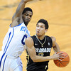 "Askia Booker of Colorado drives on Brandon Knight of New Orleans during the first half of the December 28th, 2011 game in Boulder.<br /> For more photos of the game, go to  <a href=""http://www.dailycamera.com"">http://www.dailycamera.com</a>.<br /> December 28, 2011 / Cliff Grassmick"