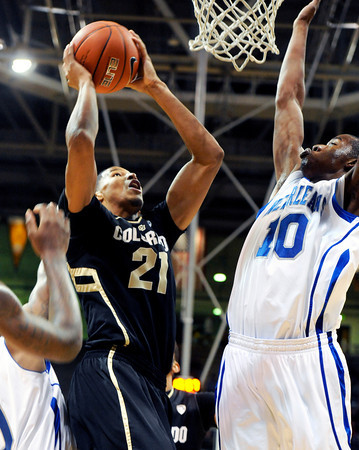 """University of Colorado's Andre Roberson goes for a shot over Antonio Wertz during a game against the University of New Orleans on Wednesday, Dec. 28, at the Coors Event Center on the CU campus in Boulder. CU won 92-34. For more photos of the game go to  <a href=""""http://www.dailycamera.com"""">http://www.dailycamera.com</a><br />  Jeremy Papasso/ Camera"""