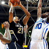 "University of Colorado's Andre Roberson goes for a shot over Antonio Wertz during a game against the University of New Orleans on Wednesday, Dec. 28, at the Coors Event Center on the CU campus in Boulder. CU won 92-34. For more photos of the game go to  <a href=""http://www.dailycamera.com"">http://www.dailycamera.com</a><br />  Jeremy Papasso/ Camera"