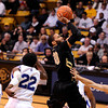"University of Colorado's Carlon Brown takes a shot over Max Banchy, No. 12, during a game against the University of New Orleans on Wednesday, Dec. 28, at the Coors Event Center on the CU campus in Boulder. CU won 92-34. For more photos of the game go to  <a href=""http://www.dailycamera.com"">http://www.dailycamera.com</a><br />  Jeremy Papasso/ Camera"