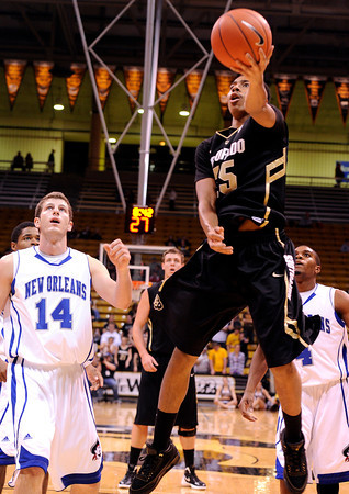 "University of Colorado's Spencer Dinwiddie goes for a lay-up during a game against the University of New Orleans on Wednesday, Dec. 28, at the Coors Event Center on the CU campus in Boulder. CU won 92-34. For more photos of the game go to  <a href=""http://www.dailycamera.com"">http://www.dailycamera.com</a><br />  Jeremy Papasso/ Camera"