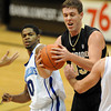 """Shane Harris-Tunks of CU gets a rebound from Brandon Knight of New Orleans.<br /> For more photos of the game, go to  <a href=""""http://www.dailycamera.com"""">http://www.dailycamera.com</a>.<br /> December 28, 2011 / Cliff Grassmick"""