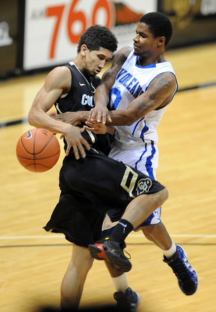 "Askia Booker of Colorado collides with  Brandon Knight of New Orleans during the first half of the December 28th, 2011 game in Boulder.<br /> For more photos of the game, go to  <a href=""http://www.dailycamera.com"">http://www.dailycamera.com</a>.<br /> December 28, 2011 / Cliff Grassmick"