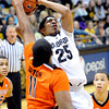 "University of Colorado's Spencer Dinwiddie takes a shot over Oregon State's Joe Burton on Thursday, Feb. 2, during a game against Oregon State at the Coors Events Center in Boulder, Colo. For more photos of the game go to  <a href=""http://www.dailycamera.com"">http://www.dailycamera.com</a><br /> Jeremy Papasso/ Camera"