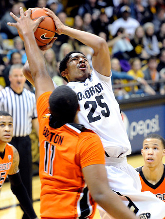 """University of Colorado's Spencer Dinwiddie takes a shot over Oregon State's Joe Burton on Thursday, Feb. 2, during a game against Oregon State at the Coors Events Center in Boulder, Colo. For more photos of the game go to  <a href=""""http://www.dailycamera.com"""">http://www.dailycamera.com</a><br /> Jeremy Papasso/ Camera"""