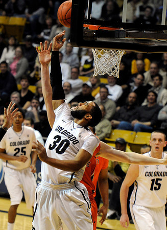 """University of Colorado's Carlon Brown goes for a lay-up over Oregon State's Kevin McSHANE on Thursday, Feb. 2, during a game against Oregon State at the Coors Events Center in Boulder, Colo. For more photos of the game go to  <a href=""""http://www.dailycamera.com"""">http://www.dailycamera.com</a><br /> Jeremy Papasso/ Camera"""