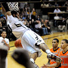 "University of Colorado's Carlon Brown hangs on the rim after slam-dunking an alley-oop pass over Oregon State's Jared Cunningham, No. 1, at right, and Eric Moreland, middle, on Thursday, Feb. 2, during a game against Oregon State at the Coors Events Center in Boulder, Colo. For more photos of the game go to  <a href=""http://www.dailycamera.com"">http://www.dailycamera.com</a><br /> Jeremy Papasso/ Camera"