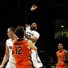 "University of Colorado's Carlon Brown takes a shot over Oregon State's Angus Brandt, No. 12, on Thursday, Feb. 2, during a game against Oregon State at the Coors Events Center in Boulder, Colo. For more photos of the game go to  <a href=""http://www.dailycamera.com"">http://www.dailycamera.com</a><br /> Jeremy Papasso/ Camera"