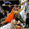 "University of Colorado's Nate Tomlinson fights for a loose ball with Oregon State's Roberto Nelson on Thursday, Feb. 2, during a game against Oregon State at the Coors Events Center in Boulder, Colo. For more photos of the game go to  <a href=""http://www.dailycamera.com"">http://www.dailycamera.com</a><br /> Jeremy Papasso/ Camera"