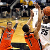 "University of Colorado's Spencer Dinwiddie takes a shot over Oregon State's Jared Cunningham, No. 1, and Eric Moreland, No. 15, on Thursday, Feb. 2, during a game against Oregon State at the Coors Events Center in Boulder, Colo. For more photos of the game go to  <a href=""http://www.dailycamera.com"">http://www.dailycamera.com</a><br /> Jeremy Papasso/ Camera"