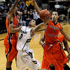 "University of Colorado's Askia Booker goes for a shot under the arms of Oregon State's Eric Moreland, left, and Jared Cunningham, right, on Thursday, Feb. 2, during a game against Oregon State at the Coors Events Center in Boulder, Colo. For more photos of the game go to  <a href=""http://www.dailycamera.com"">http://www.dailycamera.com</a><br /> Jeremy Papasso/ Camera"