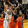 "University of Colorado's Austin Dufault takes a shot over Oregon State's Kevin McSHANE, No. 0, and Eric Moreland, No. 15, on Thursday, Feb. 2, during a game against Oregon State at the Coors Events Center in Boulder, Colo. For more photos of the game go to  <a href=""http://www.dailycamera.com"">http://www.dailycamera.com</a><br /> Jeremy Papasso/ Camera"