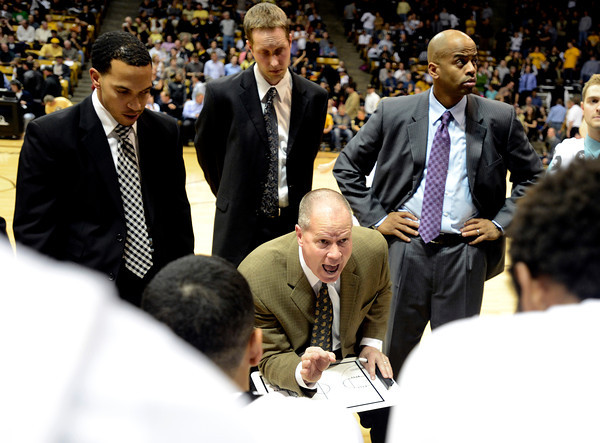 """University of Colorado Head Coach Tad Boyle, center, goes over a game plan during a time-out in a game against Texas Southern on Tuesday, Nov. 27, at the Coors Event Center on the CU campus in Boulder. For more photos of the game go to  <a href=""""http://www.dailycamera.com"""">http://www.dailycamera.com</a><br /> Jeremy Papasso/ Camera"""