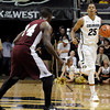 "University of Colorado's Spencer Dinwiddie moves the ball towards Raymond Penn during a game against Texas Southern on Tuesday, Nov. 27, at the Coors Event Center on the CU campus in Boulder. For more photos of the game go to  <a href=""http://www.dailycamera.com"">http://www.dailycamera.com</a><br /> Jeremy Papasso/ Camera"
