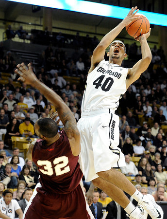 """University of Colorado's Josh Scott takes a shot over Aaron Clayborn during a game against Texas Southern on Tuesday, Nov. 27, at the Coors Event Center on the CU campus in Boulder. For more photos of the game go to  <a href=""""http://www.dailycamera.com"""">http://www.dailycamera.com</a><br /> Jeremy Papasso/ Camera"""