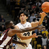 "University of Colorado's Sabatino Chen passes the ball over Fred Sturdivant during a game against Texas Southern on Tuesday, Nov. 27, at the Coors Event Center on the CU campus in Boulder. For more photos of the game go to  <a href=""http://www.dailycamera.com"">http://www.dailycamera.com</a><br /> Jeremy Papasso/ Camera"