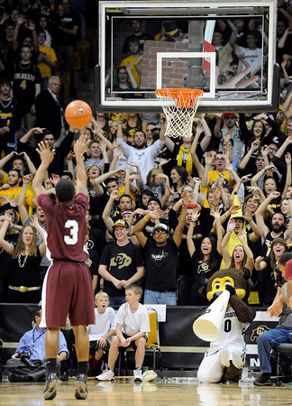 """University of Colorado fans try to distract Madarious Gibbs while he shoots a free throw during a game against CU on Tuesday, Nov. 27, at the Coors Event Center on the CU campus in Boulder. For more photos of the game go to  <a href=""""http://www.dailycamera.com"""">http://www.dailycamera.com</a><br /> Jeremy Papasso/ Camera"""