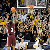 "University of Colorado fans try to distract Madarious Gibbs while he shoots a free throw during a game against CU on Tuesday, Nov. 27, at the Coors Event Center on the CU campus in Boulder. For more photos of the game go to  <a href=""http://www.dailycamera.com"">http://www.dailycamera.com</a><br /> Jeremy Papasso/ Camera"