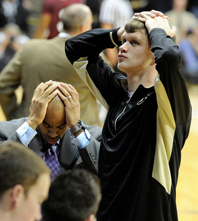 """University of Colorado's Ben Mills, right, and assistant coach Jean Prioleau react after the end of the first overtime during a game against Texas Southern on Tuesday, Nov. 27, at the Coors Event Center on the CU campus in Boulder. CU won the game 85-80 in double overtime. For more photos of the game go to  <a href=""""http://www.dailycamera.com"""">http://www.dailycamera.com</a><br /> Jeremy Papasso/ Camera"""