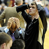 "University of Colorado's Ben Mills, right, and assistant coach Jean Prioleau react after the end of the first overtime during a game against Texas Southern on Tuesday, Nov. 27, at the Coors Event Center on the CU campus in Boulder. CU won the game 85-80 in double overtime. For more photos of the game go to  <a href=""http://www.dailycamera.com"">http://www.dailycamera.com</a><br /> Jeremy Papasso/ Camera"