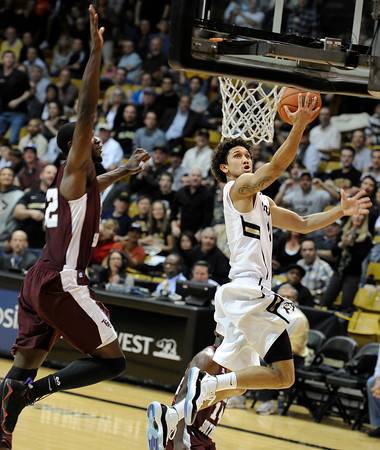 "University of Colorado's Askia Booker goes for a layup in front of Kyrie Sutton during a game against Texas Southern on Tuesday, Nov. 27, at the Coors Event Center on the CU campus in Boulder. For more photos of the game go to  <a href=""http://www.dailycamera.com"">http://www.dailycamera.com</a><br /> Jeremy Papasso/ Camera"