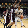 "University of Colorado's Xavier Johnson drives to the hoop past Lawrence Johnson-Danner during a game against Texas Southern on Tuesday, Nov. 27, at the Coors Event Center on the CU campus in Boulder. For more photos of the game go to  <a href=""http://www.dailycamera.com"">http://www.dailycamera.com</a><br /> Jeremy Papasso/ Camera"
