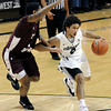 "University of Colorado's Askia Booker drives the ball past Madarious Gibbs during a game against Texas Southern on Tuesday, Nov. 27, at the Coors Event Center on the CU campus in Boulder. For more photos of the game go to  <a href=""http://www.dailycamera.com"">http://www.dailycamera.com</a><br /> Jeremy Papasso/ Camera"