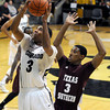 "University of Colorado's Xavier Talton takes a shot over Madarious Gibbs during a game against Texas Southern on Tuesday, Nov. 27, at the Coors Event Center on the CU campus in Boulder. For more photos of the game go to  <a href=""http://www.dailycamera.com"">http://www.dailycamera.com</a><br /> Jeremy Papasso/ Camera"