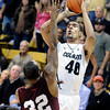 "University of Colorado's Josh Scott takes a shot over Aaron Clayborn during a game against Texas Southern on Tuesday, Nov. 27, at the Coors Event Center on the CU campus in Boulder. For more photos of the game go to  <a href=""http://www.dailycamera.com"">http://www.dailycamera.com</a><br /> Jeremy Papasso/ Camera"