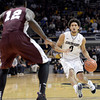 "University of Colorado's Askia Booker drives the ball past Kyrie Sutton during a game against Texas Southern on Tuesday, Nov. 27, at the Coors Event Center on the CU campus in Boulder. For more photos of the game go to  <a href=""http://www.dailycamera.com"">http://www.dailycamera.com</a><br /> Jeremy Papasso/ Camera"