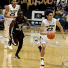 "University of Colorado's Sabatino Chen dribbles the ball past Omar Strong during a game against Texas Southern on Tuesday, Nov. 27, at the Coors Event Center on the CU campus in Boulder. For more photos of the game go to  <a href=""http://www.dailycamera.com"">http://www.dailycamera.com</a><br /> Jeremy Papasso/ Camera"