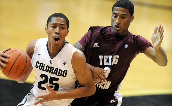 Spencer Dinwiddie of CU drives to the basket on Madarious Gibbs of Texas Southern.<br /> Cliff Grassmick / November 27, 2012