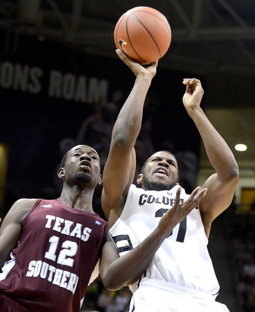 """University of Colorado's Jeremy Adams takes a shot over Kyrie Sutton during a game against Texas Southern on Tuesday, Nov. 27, at the Coors Event Center on the CU campus in Boulder. For more photos of the game go to  <a href=""""http://www.dailycamera.com"""">http://www.dailycamera.com</a><br /> Jeremy Papasso/ Camera"""