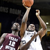 "University of Colorado's Jeremy Adams takes a shot over Kyrie Sutton during a game against Texas Southern on Tuesday, Nov. 27, at the Coors Event Center on the CU campus in Boulder. For more photos of the game go to  <a href=""http://www.dailycamera.com"">http://www.dailycamera.com</a><br /> Jeremy Papasso/ Camera"