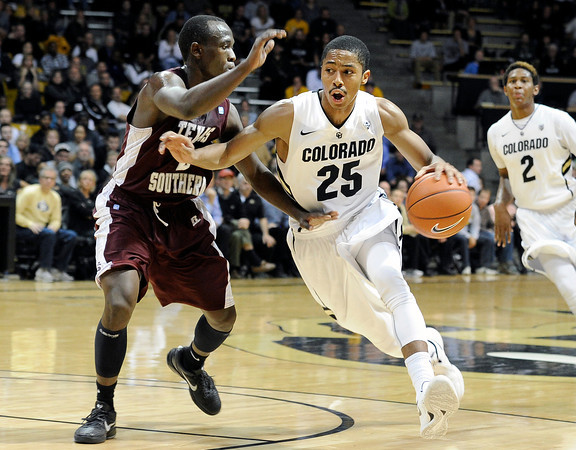 """University of Colorado's Spencer Dinwiddie drives the ball past Dexter Ellington during a game against Texas Southern on Tuesday, Nov. 27, at the Coors Event Center on the CU campus in Boulder. For more photos of the game go to  <a href=""""http://www.dailycamera.com"""">http://www.dailycamera.com</a><br /> Jeremy Papasso/ Camera"""