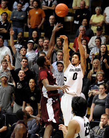 "University of Colorado's Askia Booker sinks a three-pointer to give the Buff's a 71-68 lead in the first overtime during a game against Texas Southern on Tuesday, Nov. 27, at the Coors Event Center on the CU campus in Boulder. For more photos of the game go to  <a href=""http://www.dailycamera.com"">http://www.dailycamera.com</a><br /> Jeremy Papasso/ Camera"