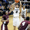 "University of Colorado's Askia Booker takes a shot over Madarious Gibbs, left, and Fred Sturdivant, right, during a game against Texas Southern on Tuesday, Nov. 27, at the Coors Event Center on the CU campus in Boulder. For more photos of the game go to  <a href=""http://www.dailycamera.com"">http://www.dailycamera.com</a><br /> Jeremy Papasso/ Camera"