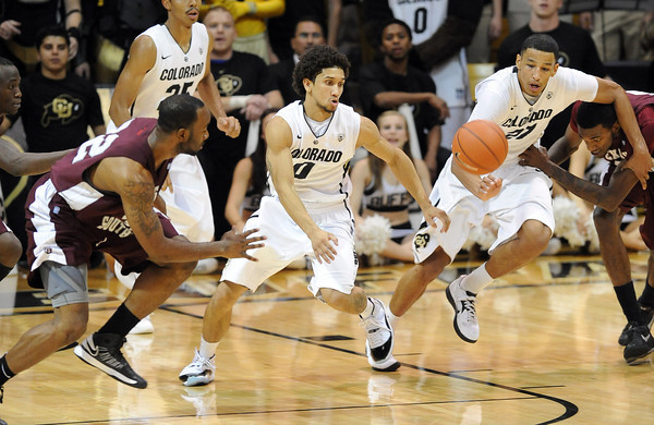 Askia Booker, left, and Andre Roberson, both of CU, get a steal against Texas Southern.<br /> Cliff Grassmick / November 27, 2012