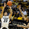 "University of Colorado's Sabatino Chen takes a shot over Spencer Collins during a game against the Wofford Terriers on Friday, Nov. 9, at the Coors Event Center on the CU campus in Boulder. For more photos of the game go to  <a href=""http://www.dailycamera.com"">http://www.dailycamera.com</a><br /> Jeremy Papasso/ Camera"