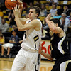 "University of Colorado's Eli Stalzer passes the ball in front of Indiana Faithfull during a game against the Wofford Terriers on Friday, Nov. 9, at the Coors Event Center on the CU campus in Boulder. For more photos of the game go to  <a href=""http://www.dailycamera.com"">http://www.dailycamera.com</a><br /> Jeremy Papasso/ Camera"