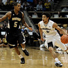 "University of Colorado's Askia Booker drives past Jarell Byrd during a game against the Wofford Terriers on Friday, Nov. 9, at the Coors Event Center on the CU campus in Boulder. For more photos of the game go to  <a href=""http://www.dailycamera.com"">http://www.dailycamera.com</a><br /> Jeremy Papasso/ Camera"