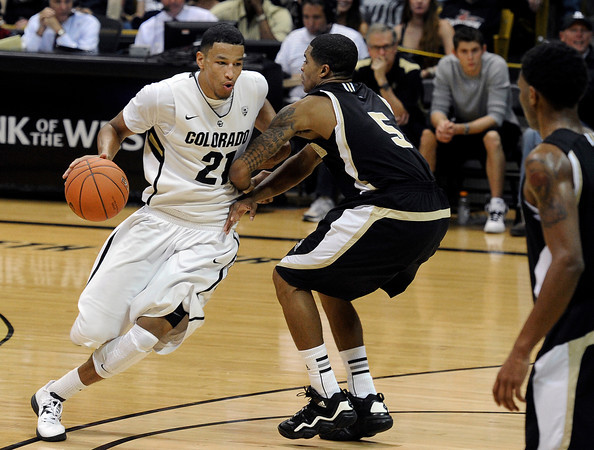 "University of Colorado's Andre Roberson drives past Jarell Byrd during a game against the Wofford Terriers on Friday, Nov. 9, at the Coors Event Center on the CU campus in Boulder. For more photos of the game go to  <a href=""http://www.dailycamera.com"">http://www.dailycamera.com</a><br /> Jeremy Papasso/ Camera"